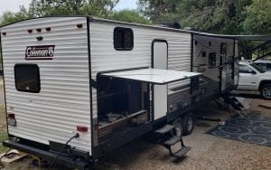 Exterior view of a RV rental with 2 canopys out