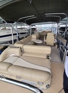Rear to front view of boat, sitting areas and a canopy top