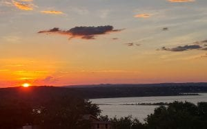 Sunset over Canyon lake over the distant mountains